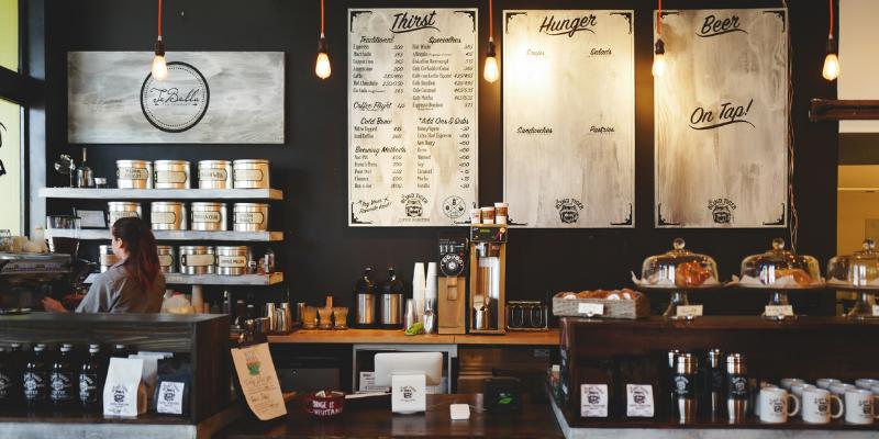Coffee shop showing logo and menu.