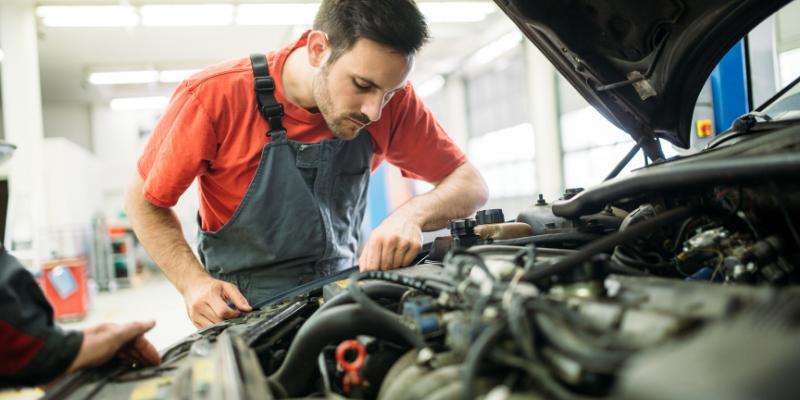 Mechanic working on a car.