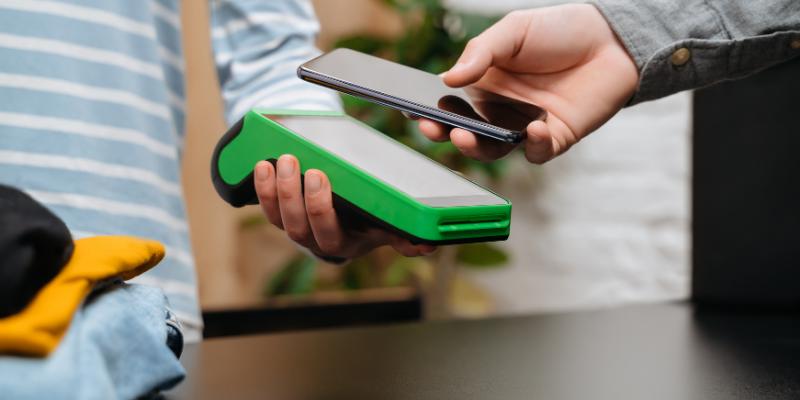 Customer using his phone to scan his digital loyalty card.