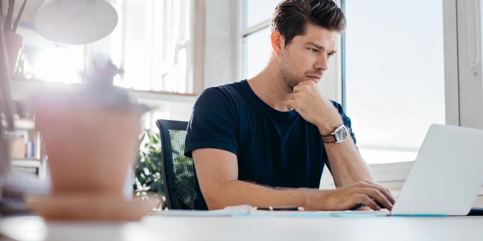 man looking at a computer