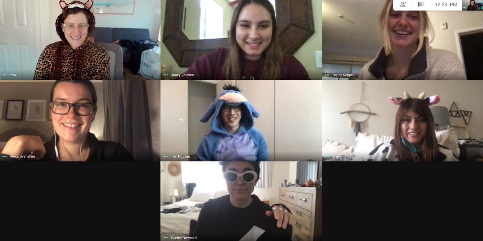 screenshot of a virtual marketing team meeting with halloween costumes