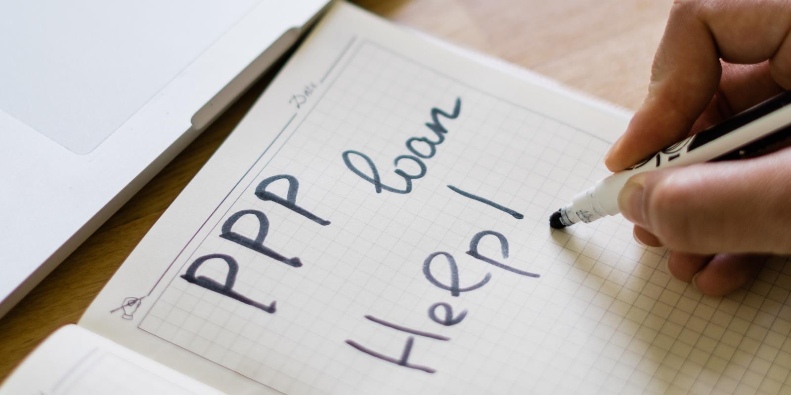 ppp loan help written on a piece of paper